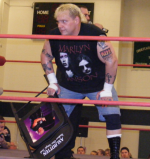 Axl Rotten - Rotten holding one of his signature chairs in 2009