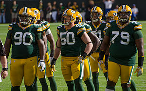 Ryan Pickett - Ryan Pickett (right) with B. J. Raji and A. J. Hawk.