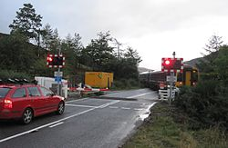 Balnacra Level Crossing - with new barriers (10422435565).jpg