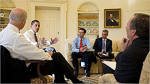 Lawrence Summers - President Barack Obama, on left, discusses with a group in the White House, including Larry Summers on far right (back to camera)