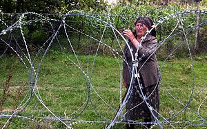 Occupied territories of Georgia - A Georgian villager is left beyond the barbed-wire fence installed by the Russian troops along the South Ossetia–Georgia demarcation line in September 2013.