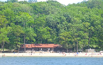 Pokagon State Park - The Beach House, on the western edge of Pokagon, as seen from Lake James. Behind the Beach House, the land quickly rises to a bluff overlooking the lake.