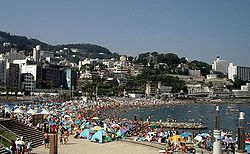 Beach in Atami City with sea bathers