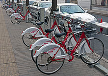 A rack of red-and-white bicycles, locked into place