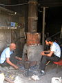 Blacksmith and his son in the Bazaar of Nishapur 5.JPG