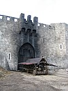 Burnt-out castle gate and battering ram