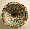 Bowl with bird, Aghkand ware, Northwestern Iran, Seljuk period, 12th or 13th century AD, earthenware with white slip, painted in green & brown with incised outlines - Cincinnati Art Museum - DSC03984.JPG