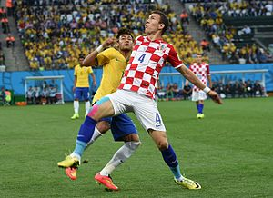 Ivan Perišić - Perišić playing for Croatia at the 2014 World Cup, contesting for the ball against Brazil's Neymar