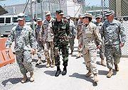 Brigadier General Thomas W. Hartmann tours Guantanamo