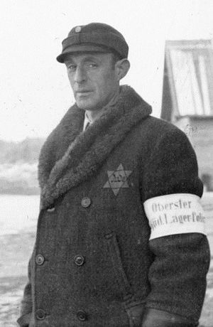 Kapo (concentration camp) - A kapo leader at Salaspils concentration camp, Latvia,  with a Lagerpolizist (camp policeman) armband