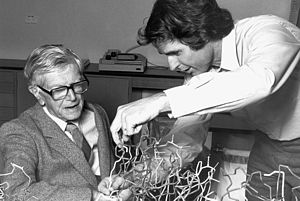 Frank Macfarlane Burnet - Peter Colman, Officer of the CSIRO at the Division of Protein Chemistry, showing his flu protein (neuraminidase) model to Frank Macfarlane Burnet.