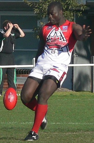 Canada national Australian rules football team - Northwind's All-International ruckman Manny Matata kicking a drop punt