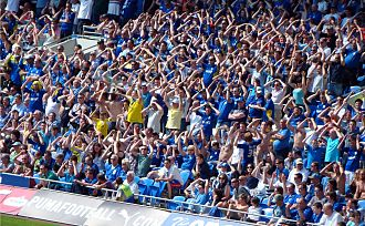 "Cardiff City F.C. - Cardiff City fans performing ""the Ayatollah"" in 2011"