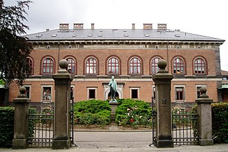 Carlsberg (district) - The Carlsberg Laboratory and in the foreground a statue of its founder J.C. Jacobsen.