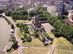 Western part of Castle Park, with ruined St Peter's church in centre and Bristol Bridge just visible in top left. The old city lies beyond.