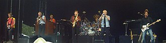 Chicago (band) - Chicago in 2004 (l–r): Howland, Pankow, Champlin, Parazaider, Imboden, Loughnane, Scheff and Lamm (behind Scheff)