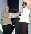 """Chowdhury Mohan Jatua presenting the award for the Best Actor to Mr. Sasson Gabey for the film """"Restoration"""" at the closing ceremony of the 42nd International Film Festival of India (IFFI-2011), at Panaji, Goa.jpg"""