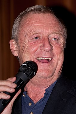 Chris Tarrant was host of the original British version, from its debut in September 1998, until its final episode in February 2014 Chris Tarrant Phooto.jpg