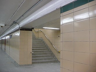 Christie station - Different colour of trim tiles on either side of the exit stairway; new red-brown and the original green