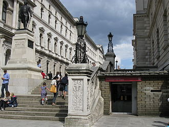 Churchill War Rooms - Public entrance, before the 2012 redesign, Clive Steps with the Treasury building on the right and the Foreign and Commonwealth Office on the left.