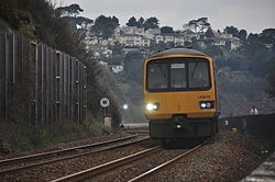 Class 143 on the sea wall at Teignmouth (0160).jpg