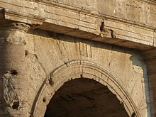 Entrance LII of the Colosseum, withRoman numerals still visible