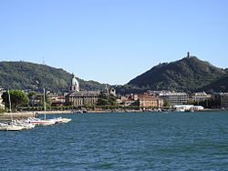 View from Lake Como. The tower which tops the hill on the right is the Castello Baradello.