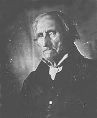 A black-and-white photo of Heyer's face