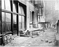Construction materials in alley next to the Smith Tower construction site, Seattle, Washington, January 2, 1912 (SEATTLE 4873).jpg