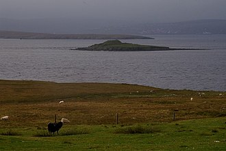 Yell, Shetland - The ruins of the broch on the Holm of Copister can clearly be seen in this view from Copister