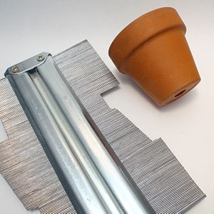 Profile gauge - A contour gauge set to the profile of a little pot