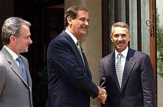 Roberto Madrazo - Santiago Creel (left), President Vicente Fox and Roberto Madrazo (right).