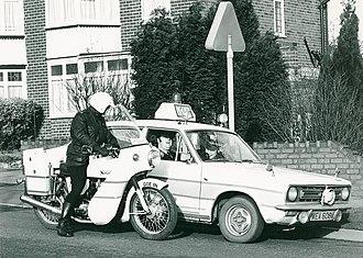 Norton Commando - West Midlands Police 1974 or '75 Norton Interpol (left) beside a Morris Marina patrol car
