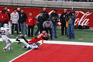 2010 Utah Utes football team - DeVonte Christopher catches a touchdown pass over Brian Logan; with the extra point Utah cut BYU's lead to 13–10.