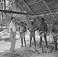 De heer Tjin A Djie met arbeiders van de houtfabriek met bijlen, Bestanddeelnr 252-2525.jpg