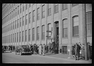 Brown & Sharpe - Employees leaving Brown and Sharpe Manufacturing Company, December 1940. Photo by Jack Delano.