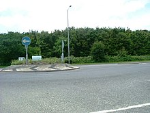 Denham Roundabout, with a blue one-way road sign