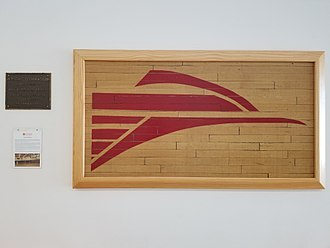 College of the Desert - On a wall inside of the Cravens Student Services Center, sits a display of the old center court Roadrunners logo and plaque from the old Wright Gym.