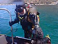 Diver boarding using dive boat ladder P3070567.jpg