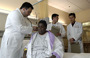 Doctor–patient relationship - A physician performs a standard physical examination on his patient.