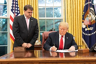 Robert Wilkie - Wilkie watches as President Donald Trump signs The Veterans Treatment Court Improvement Act of 2018
