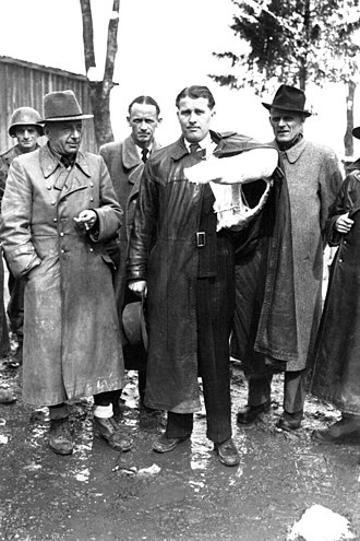 Wernher von Braun - Von Braun, with his arm in a cast due to a car accident, surrendered to the Americans just before this May 3, 1945 photo.