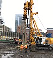 Drilling of foundation piles that will support a personnel footbridge spanning across the future LIRR Mid-day Storage Yard. (CQ033, 2-20-2018) (39727883114).jpg