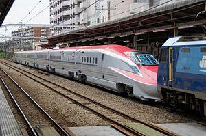 E6 Series Shinkansen - Set Z9 hauled by an EH200 electric locomotive en route from the Kawasaki Heavy Industries factory in Kobe to Akita Depot, June 2013