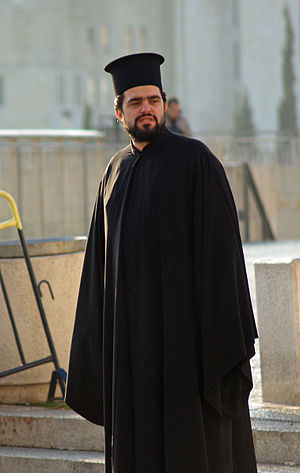 Kalimavkion - Greek Orthodox clergyman wearing clerical kalimavkion.