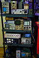 Electronic measurement equipment rack - Setting up for Project X party at Noisebridge, San Francisco (2015-02-28 18.52.19 by Mitch Altman).jpg