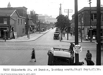 The Ward, Toronto - Looking south from the centre of St. John's Ward at Albert Street (Dundas Street) and Elizabeth Street. c. 1930
