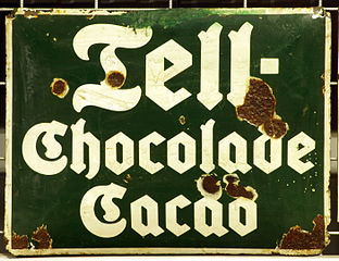 http://upload.wikimedia.org/wikipedia/commons/thumb/6/6b/Enamel_advertising_sign%2C_Tell-Chocolade_Cacao.JPG/312px-Enamel_advertising_sign%2C_Tell-Chocolade_Cacao.JPG