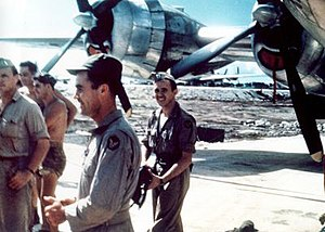 Theodore Van Kirk - Van Kirk (center) and the rest of the Enola Gay flight crew upon return from their mission over Hiroshima (6 August 1945)
