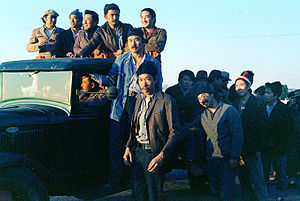 """Frank Chin - A snapshot from director John Korty's """"Farewell to Manzanar."""" Chin is in the foreground, with Lawson Inada directly behind. Photo by Nancy Wong 1976."""